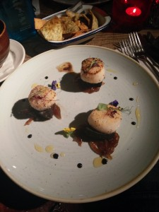 Scallops of the Day with black pudding and caramelised red onion.